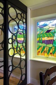 LJM stain glass window